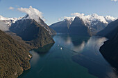 Aerial view of Milford Sound with the snowcapped mountain of Mitre Peak, Milford Sound, Fiordland National Park, South Island, New Zealand