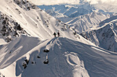 Aerial of Snowboarder standing on a mountain peak, South Island, New Zealand