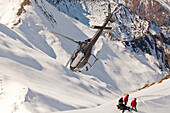 Helicopter landing with winter sportsmen, Skiers and snowboarders, South Island, New Zealand