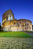 Illuminated Colosseum of Rome with antique cobblestone in foreground, UNESCO World Heritage Site Rome, Rome, Latium, Lazio, Italy