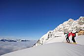 Two backcountry skiers ascending to hut Gurttenhuette, Kaiser-Express, Rote-Rinn-Scharte, Wilder Kaiser, Kaiser mountain range, Tyrol, Austria