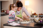Mother and daughter baking cookies, Styria, Austria