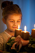 Girl (4 years) looking at an Advent wreath