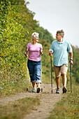 Senior couple nordic walking, Vienna, Austria
