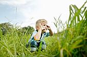 Boy crouching on grass, Vienna, Austria