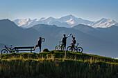Mountain bikers at Lake Salvensee, Hohe Salve, Kitzbuehel Horn, Kitzbuehel Alps, Tyrol, Austria