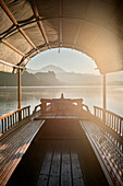 View at castle at Lake Bled from a typical Gondola, mist, steam, Julian Alps, Gorenjska, Slovenia