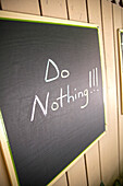 Blackboard with relaxing slogan of the day, Do Nothing, Little Palm Island Resort, Florida Keys, USA