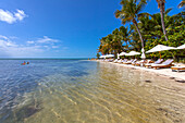 Beach with tourists, Little Palm Island Resort, Florida Keys, USA
