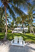 Beach at the Moorings Village Resort with wooden villa BLUE CHARLOTTE in the background, Islamorada, Florida Keys, Florida, USA