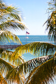 American flag on the beach of Reach Resort, Key West, Florida Keys, USA
