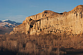 Panoramic view of Bamiyan and the escarpment with hundreds of caves, Bamian Province, Afghanistan