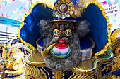 Morenada dancer wearing an elaborate mask and costume in the procession of the Carnaval de Oruro, Oruro, Bolivia