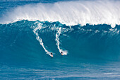 Hawaii, Maui, Peahi (Jaws), Two surfer ride a giant wave