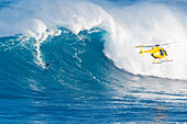 Hawaii, Maui, Peahi (Jaws), Helicopter, Surfer rides a giant wave