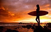 Hawaii, Maui, Makena, Silhouette of surfer girl at sunset