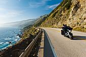 California, Big Sur, Coastal shot of Highway 1 with motorcycle driving