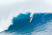 Hawaii, Maui, Peahi, Professional surfer Danilo Couto rides a wave at Peahi, also know as Jaws. FOR EDITORIAL USE ONLY.