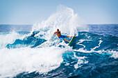 Hawaii, Maui, Kapalua, Professional surfer Flynn Novak carves a powerful turn. FOR EDITORIAL USE ONLY.
