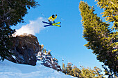 California, Mammoth Mountain, Skier jumping off cliff. EDITORIAL USE ONLY.