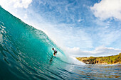 Hawaii, Maui, Honolua Bay, Surfer on epic wave at sunset. FOR EDITORIAL USE ONLY.