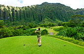 Hawaii, Oahu, Honolulu, Ko'olau Golf Course, Man drives at the fifth hole.