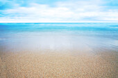 Hawaii, Oahu, Beautiful Seascape of the ocean and sand.