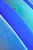 Hawaii, Oahu, Pattern shot of blue Kayaks stacked on each other.