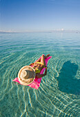 French Polynesia, Tahiti, Moorea, Woman floating in water.
