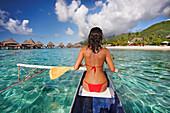 French Polynesia, Bora Bora, Female kayaker enjoying a day on the water.