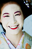 Portrait of Japanese Maiko with big smile.