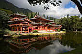 Hawaii, Oahu, Ahuimanu Valley, Valley of the Temples, Byodo-In Temple, reflection in pond.