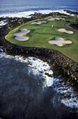 Hawaii, Big Island, Kohala Coast, Mauna Lani Resort, Francis I'i Brown Golf Course, couple golfing at 15th hole