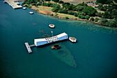 Hawaii, Oahu, Pearl Harbor, Arizona Memorial aerial view with ship visible below A42A
