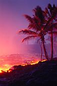 Hawaii, Big Island, Kalapana, lava flowing into ocean, palm trees, glowing A27G