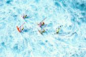 Hawaii, Maui, Ho'okipa, group windsurfing in whitewash ocean, aerial shot A10C