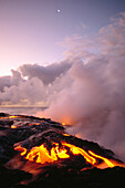 Hawaii, Big Island, Hawaii Volcanoes National Park, Sunrise at ocean front with lava flow, smoky skies