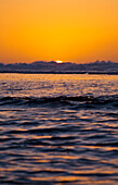 Hawaii, Kauai, Na Pali Coast, Beautiful orange sunset over ocean along Ke'e Beach.