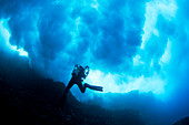 Hawaii, Lanai, Diver near Cathedral underneath a billowing wave.