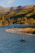 United States, Alaska, Kenai River, fishermen, pontoon boat in foreground.