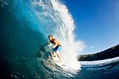 Hawaii, Maui, Kapalua, Professional surfer Kevin Sullivan rides a wave at Honolua Bay. EDITORIAL USE ONLY.
