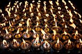 'Boudhnath, Kathmandu, Nepal; Candles Burning In Rows'