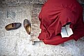 'Buddhist Monk Reading In Stupa; Boudhanath, Nepal'