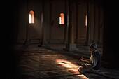 'Muslim Man Praying In Mosque; Jamia Masjid, Srinagar, Kashmir, India'