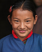 'A Young Girl In A Blue Robe At The National Memorial Chorten; Thimphu Thimphu District Bhutan'