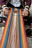 'A Person Weaving Colorful Fabric; Cusco Peru'