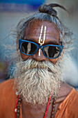 'A Holy Man Wearing Sunglasses With A Third Eye Painted On His Forehead; Haridwar India'