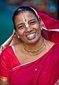 'Portrait Of A Woman Wearing A Red Sari With A Bindi; India'