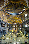 Turkey, Istanbul, Sultanahmet. Interior of Haghia Sophia with domed ceiling and decorative mosaic tiled walls
