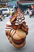 Vietnam,Hanoi,Mobile Conical Hat and Basketware Vendor